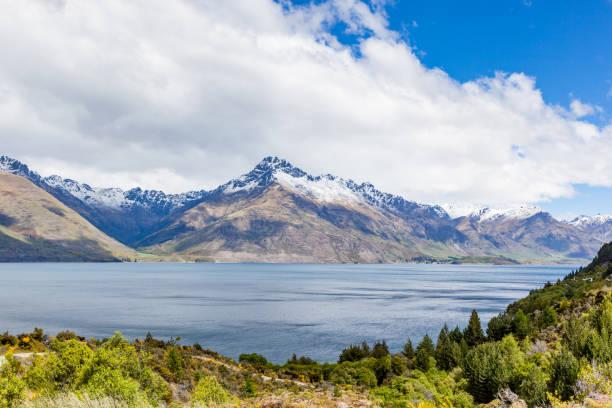 Travel destination, lake and alpine landscape stock photo