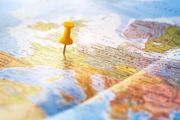 travel destination, pin on the world map - europe map stock photos and pictures