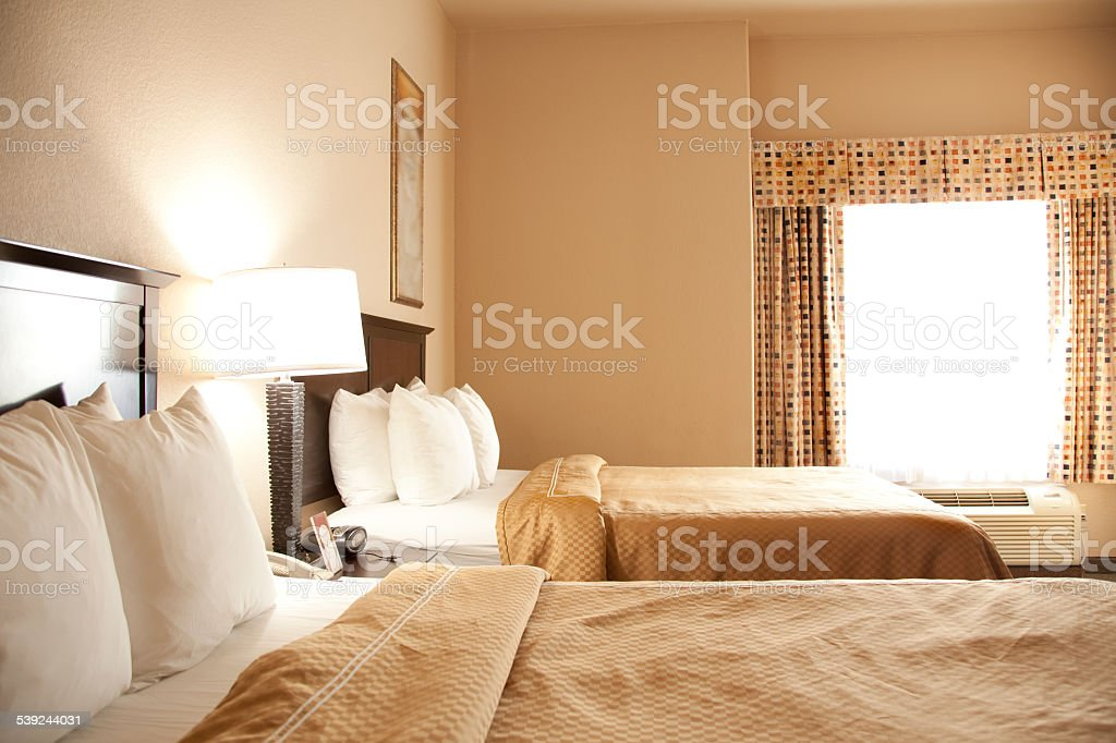 Travel Destinations: Hotel room double beds, window. royalty-free stock photo