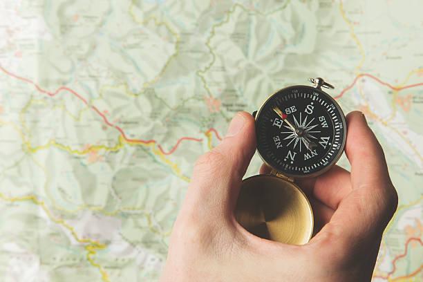 travel direction - kompass wanderkarte stock-fotos und bilder