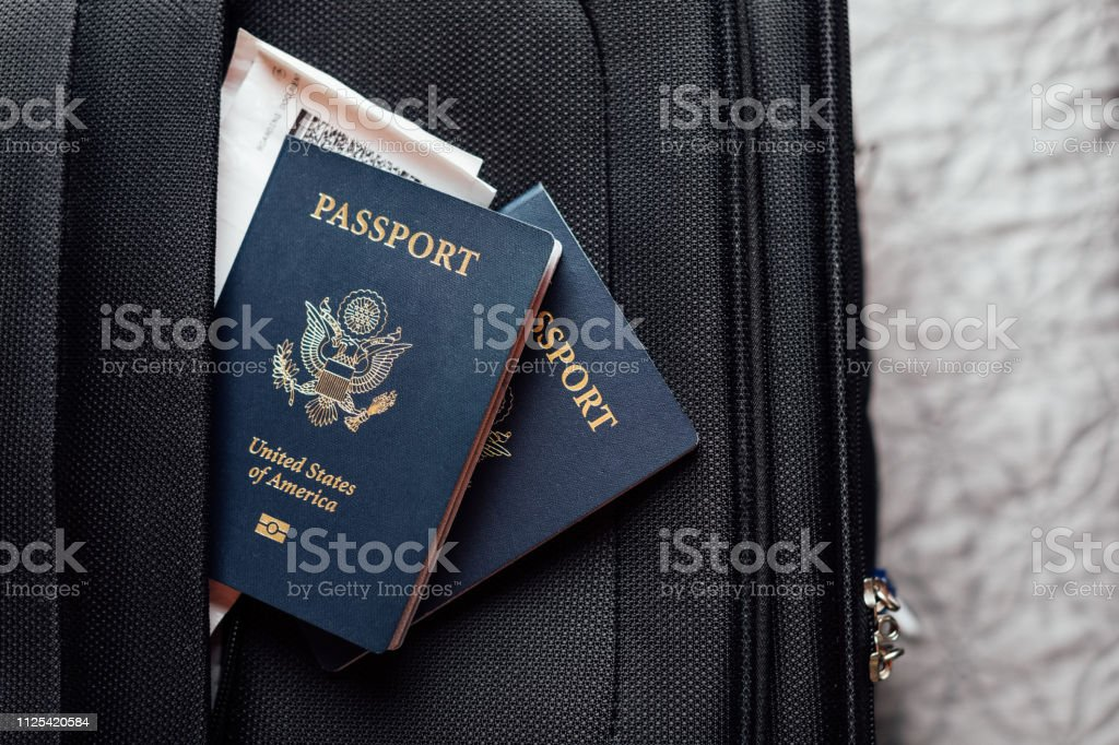 travel documents on suitcase stock photo