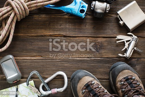 istock Travel equipment for mountain trip on wood floor. Top view 492735820