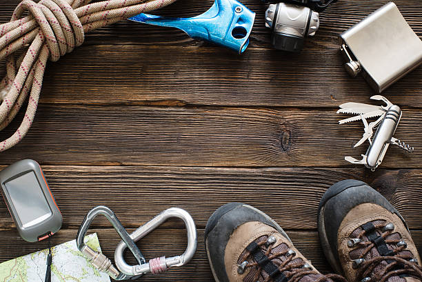 Travel equipment for mountain trip on wood floor. Top view stock photo