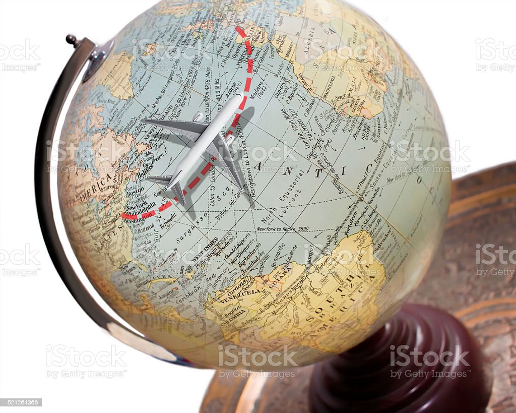 Travel Flying Concept. Model Airplane Vintage Globe. Transatlantic Vacation Destination stock photo