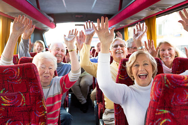 Travel Fun Elderly friends having fun on coach journey. field trip stock pictures, royalty-free photos & images