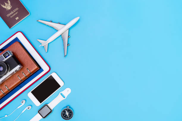 travel gadgets and objects on blue copy space - phone, travelling, copy space imagens e fotografias de stock