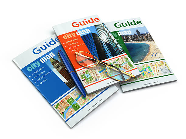 Travel guide books on white isolated background. stock photo