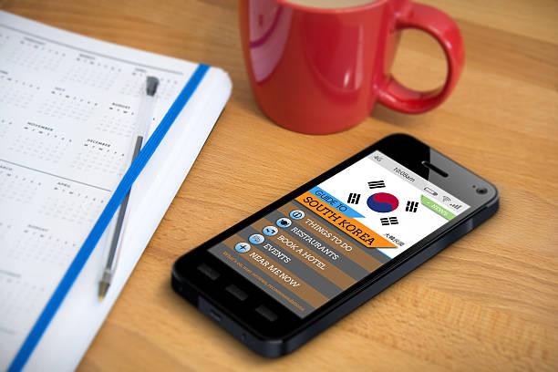 Travel Guide - South Korea - Smartphone App stock photo