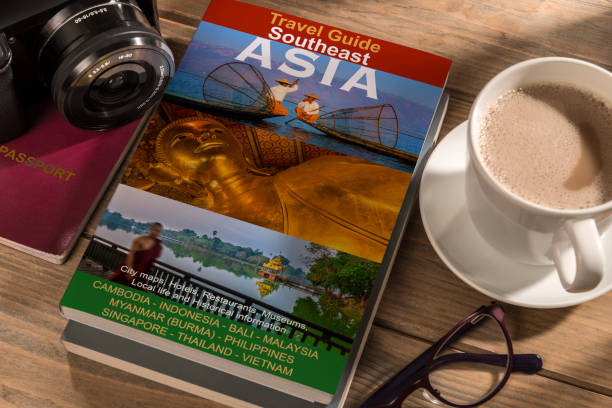 Travel Guide southeast Asia Travel Guide to southeast Asia on the table. Photographer's own book cover design. pasport malaysia stock pictures, royalty-free photos & images