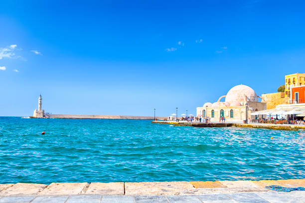 Travel ideas. Chania Old Port and Venetian Harbor With Ancient Lighthouse on Background.Horizontal Image