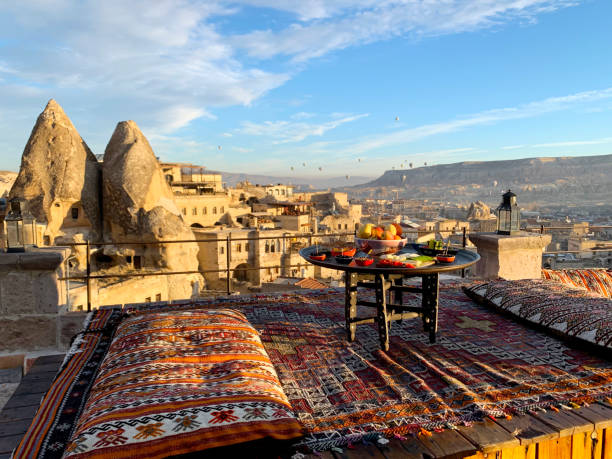Travel in Cappadocia Colorful hot air balloons flying over the valley sunrise time with special breakfast travel destination in Turkey stock photo