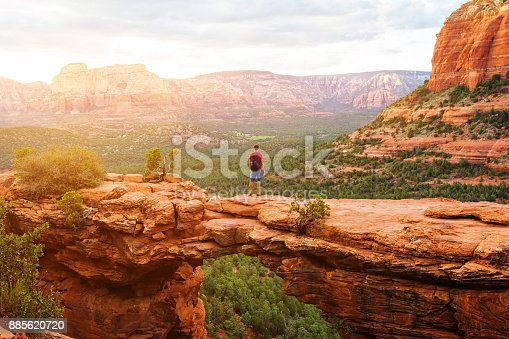 Travel in Devil's Bridge Trail, man Hiker with backpack enjoying view, Sedona, Arizona, USA
