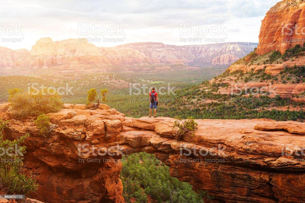 Travel in Devil's Bridge Trail, man Hiker with backpack enjoying view, Sedona, Arizona, USA stock photo
