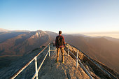 Travel in Sequoia National Park, man Hiker with backpack enjoying view, Moro Rock, California, USA