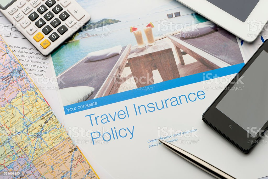 Travel insurance brochures and magazines. stock photo