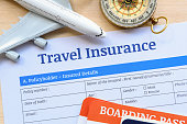 istock Travel insurance form put on a wood table. 868511790