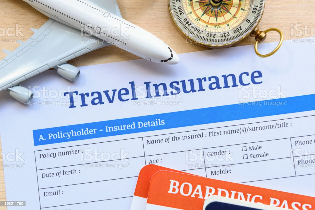 Travel insurance form put on a wood table. stock photo