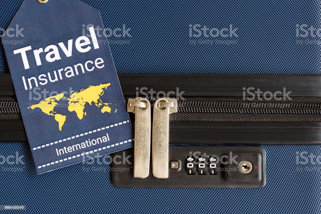 Travel insurance label is put near a numeric combination locks. stock photo