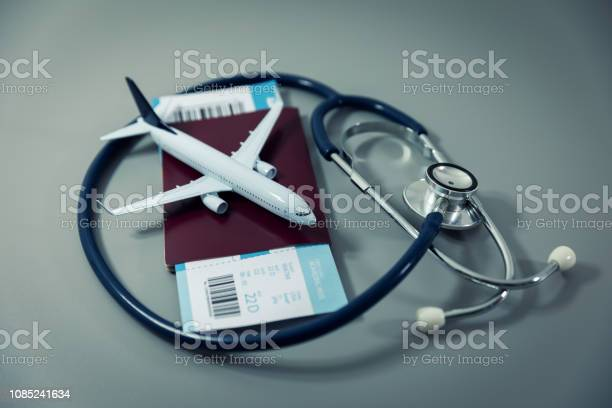 Travel insurance passport with flight ticket and stethoscope on gray picture id1085241634?b=1&k=6&m=1085241634&s=612x612&h=jti lf1zpga4pl9ctmxudsvvt ewzjmztputhsielvk=