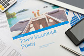 istock Travel insurance policy document with paperwork and technology. 527569103