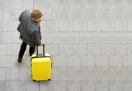 istock Travel man walking with suitcase 504874312