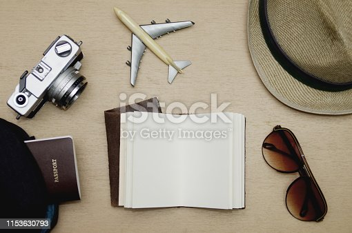istock Travel objects flat lay on wooden table, Vacation concept 1153630793