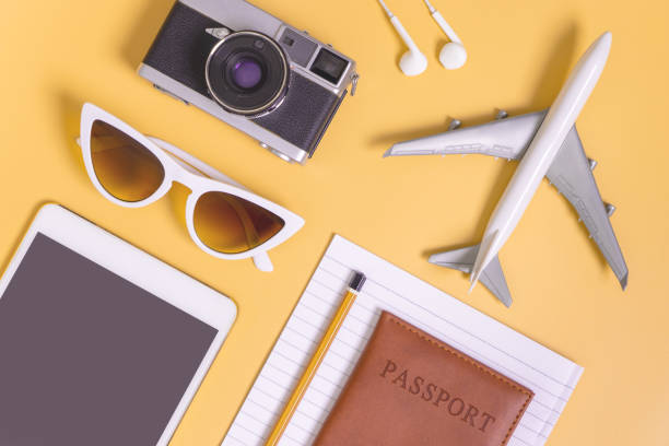 travel objects flat lay on yellow background for travel concept - phone, travelling, copy space imagens e fotografias de stock