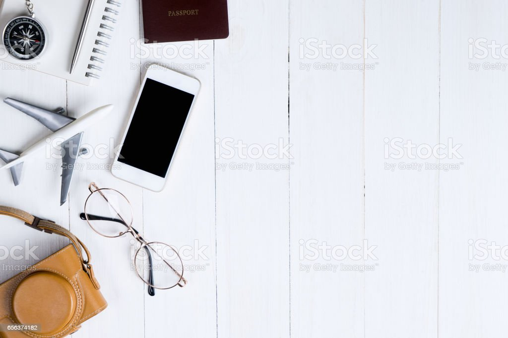 Travel objects flatlay on white wooden with copy space stock photo