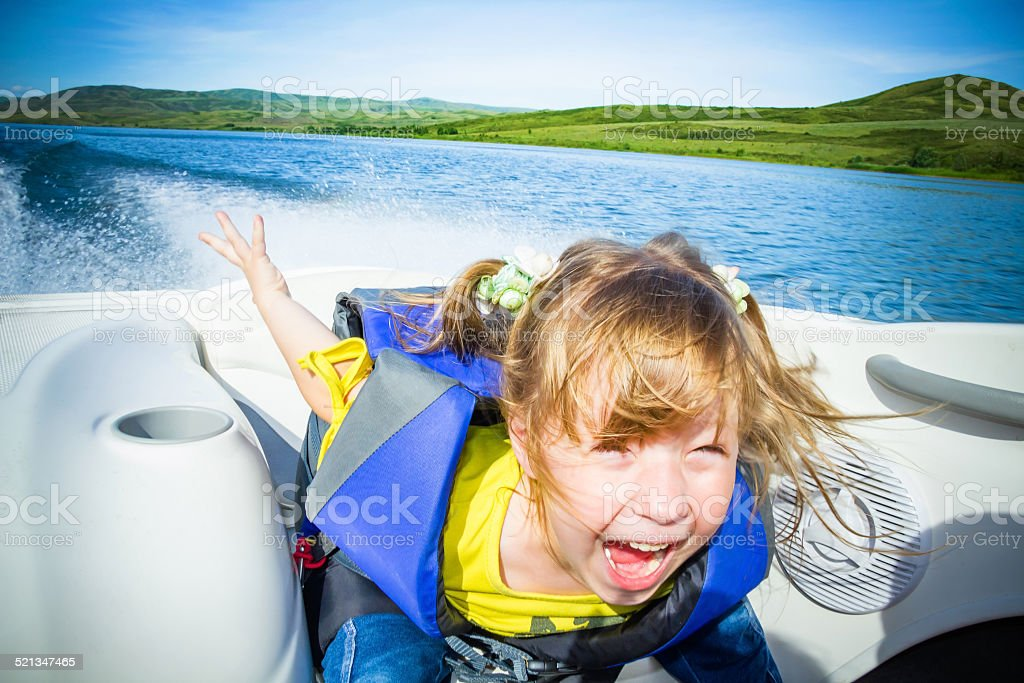 Travel of children on water in the boat stock photo