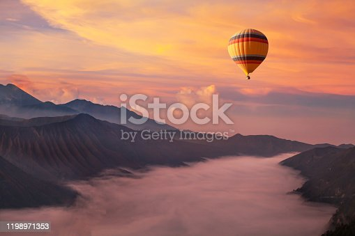 travel on hot air balloon, beautiful inspirational landscape with sunrise colorful sky
