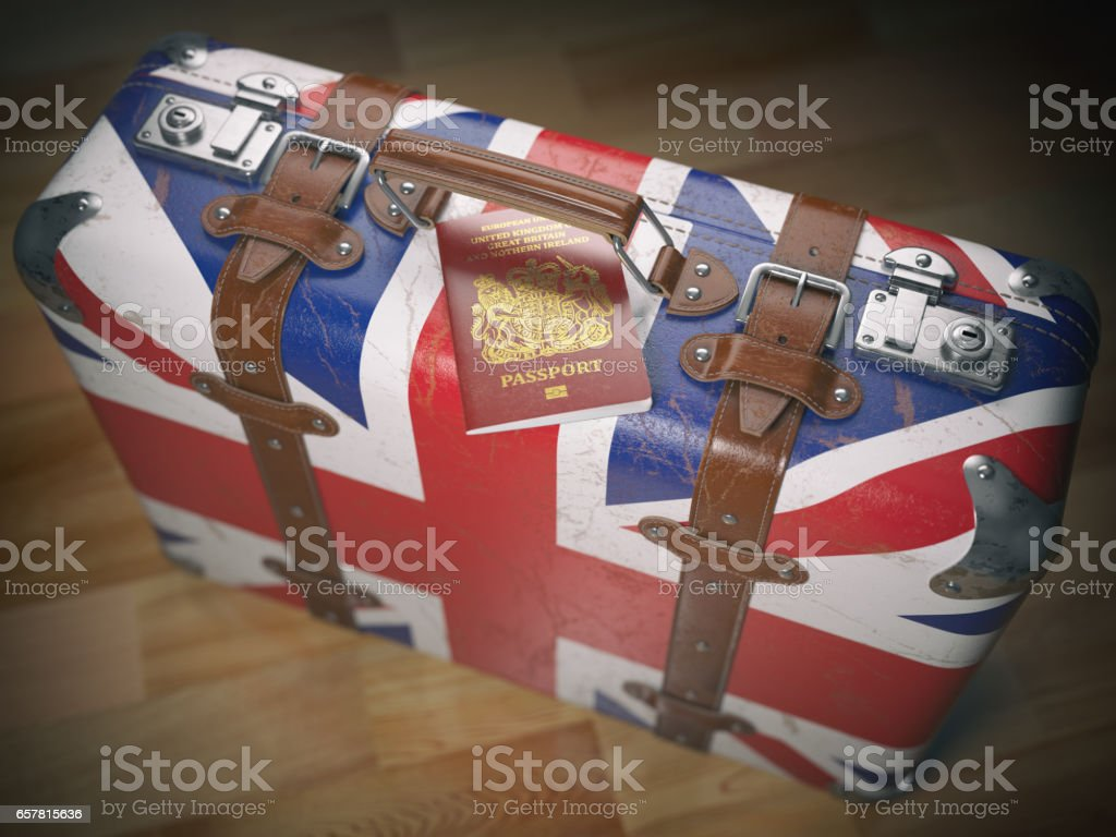 Travel or immigration. Passport and suitcase with flag of UK stock photo