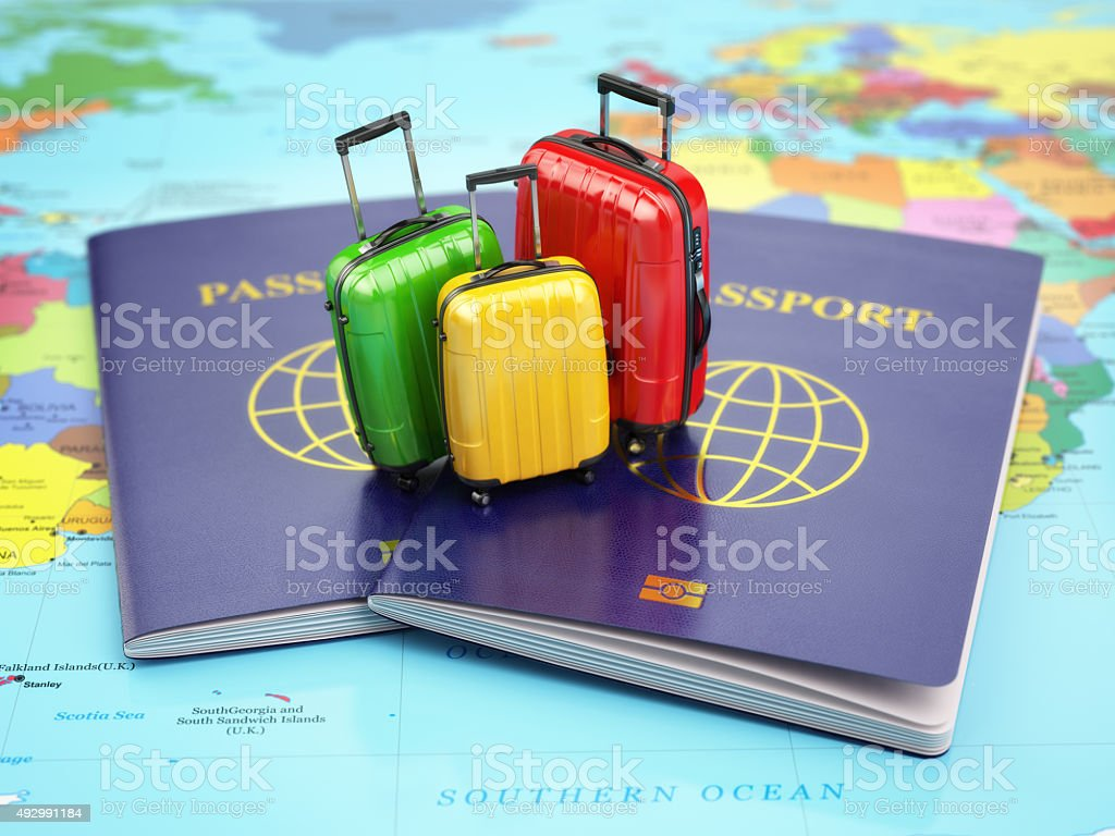 Travel or tourism concept. Passport and suitcases on the map stock photo