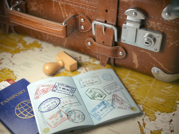 Travel or turism concept.  Old  suitcase  with opened passport Travel or turism concept.  Old  suitcase  with opened passport with visa stamps. 3d illustration    passport stamp stock pictures, royalty-free photos & images