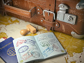 Travel or turism concept.  Old  suitcase  with opened passport