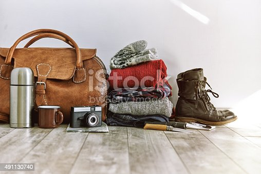 vintage bag with clothes and accesoriese for travel