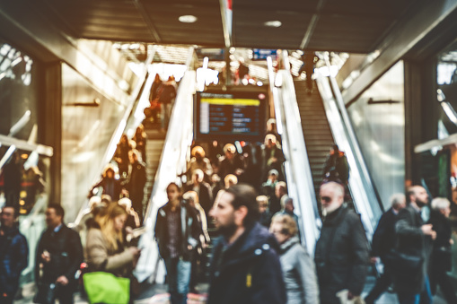 travel people on escalator - concept blur