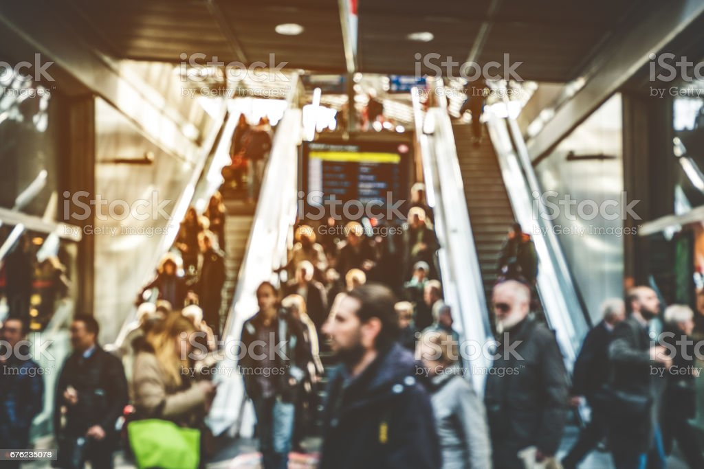 travel people on escalator - concept blur stock photo