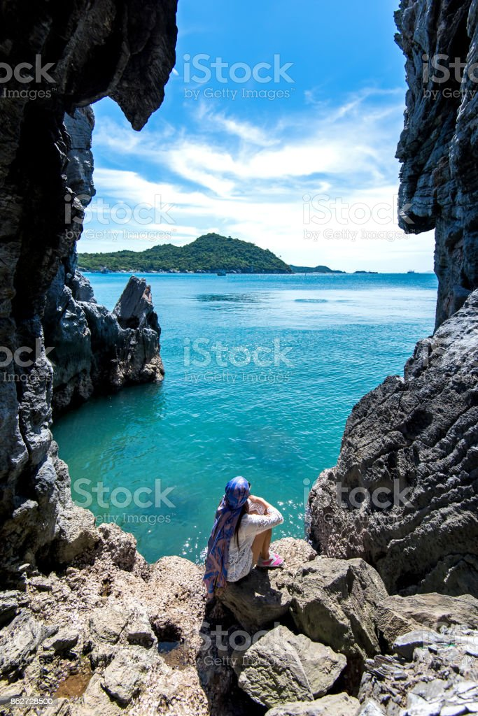 Travel people women tourist in a cave near the sea in Keo Sichang, holiday tourist, Thailand. Travel Concept stock photo