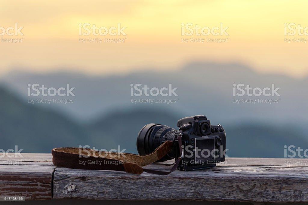 Travel photographer equipment with beautiful landscape – zdjęcie