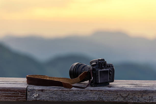 travel photographer equipment with beautiful landscape - camera photographic equipment stock photos and pictures