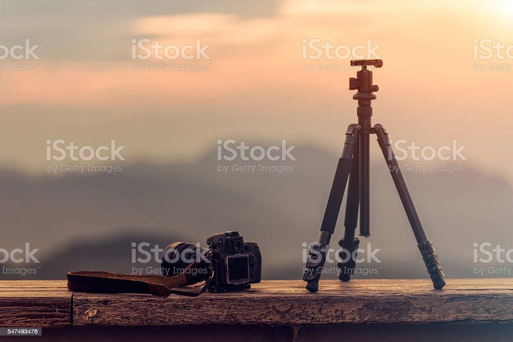 Travel photographer equipment with beautiful landscape stock photo