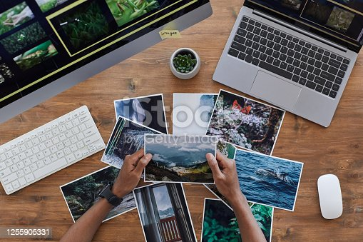 istock Travel Photographer Holding Pictures Top View 1255905331