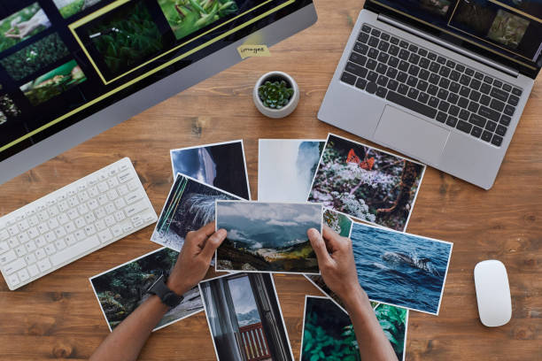 Travel Photographer Holding Pictures Top View stock photo