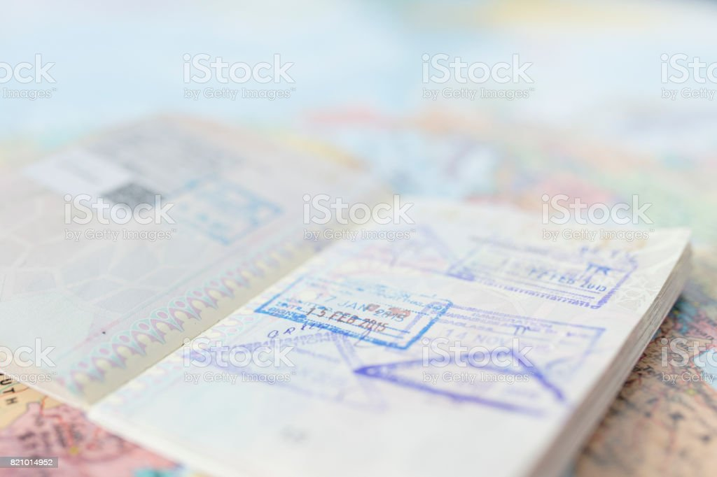 Travel plan concept and preparing to travel , Passport , money, telephone on world map background (Selective Focus) stock photo