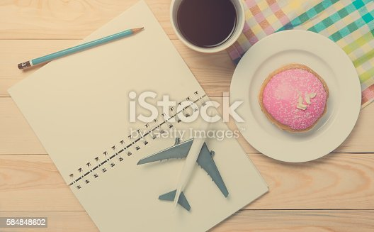 istock Travel planning in cafe with pencil vintage pastel tone. 584848602