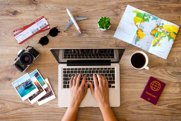 Travel planning Woman using laptop and making a reservation for her travel. travel stock pictures, royalty-free photos & images