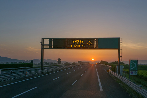 Travel restrictions due to COVID-19 coronavirus pandemic, highway information saying CLOSED DUE TO COVID-19
