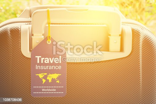 istock Travel safety and travel insurance concept : Travel insurance tag is hung near a numeric combination lock. Travel insurance is intended to cover lost luggage, trip cancellation, accident, losses, etc 1038708436