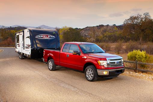 Ojai, California USA - November 13, 2013: Ford pickup pulling a trailer in beautiful Ojai ca.