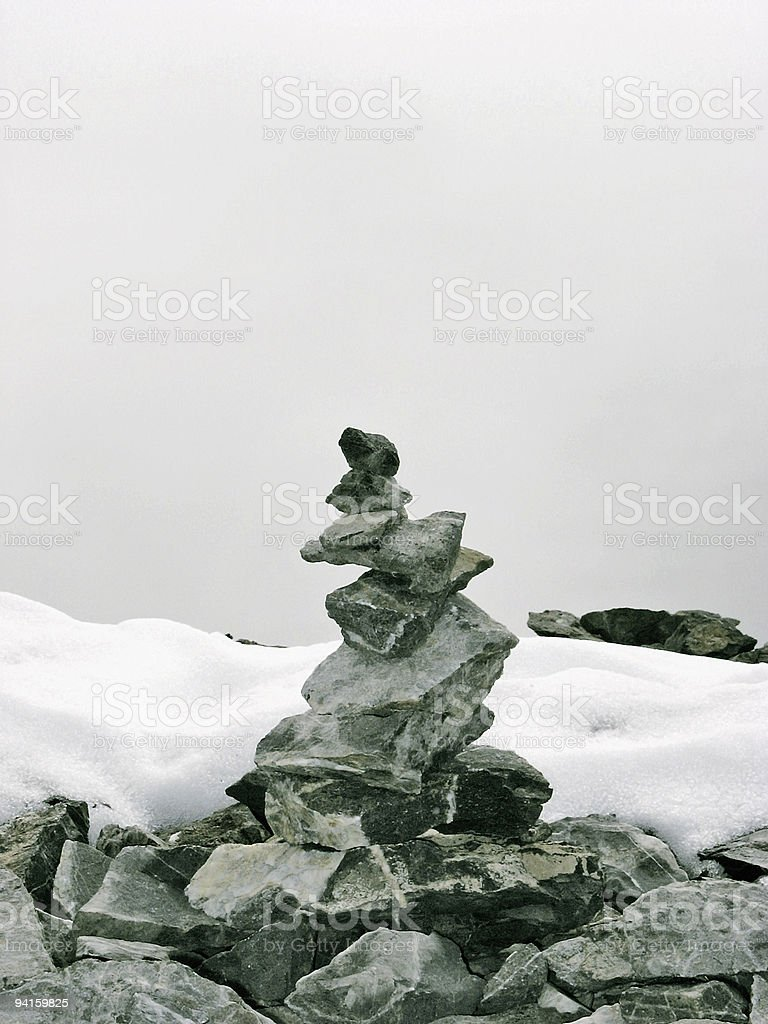 Travel; Stone marker on a mountain summit stock photo